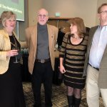 Museum executive director Laurie Risch with Gregg Harper, Janet and Bryan Harper