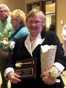 Clara Berger received a plaque and a vase made by Sandy Manteuffel.