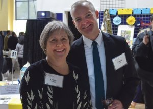 Vice chair Linda Holthaus with Travis Rowley of the school's corporate work-study program