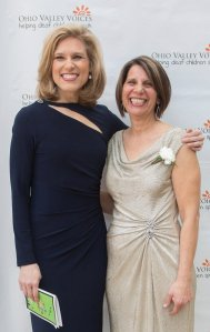 Emcee Kristyn Hartman of WCPO and OVV Executive Director Maria Sentelik