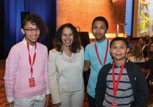 Zhanya Ruffin with speaker Nakya Lovett, Zahir Ruffin and Zyan Ruffin