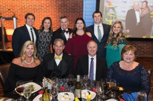 At sponsor Duke Energy's table: (back) Phil Ruschman, Casey Ruschman, Jim Henning, Christine Henning, Jake Messmer and Haley Elliston; (front) Sally Thelan, Tom Thelan, Dave Emerick and Tina Emerick