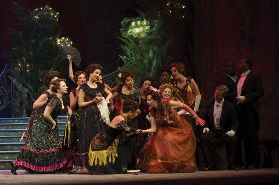 """A scene from Act II of Cincinnati Opera's production of """"La Traviata"""" (Pictured: Stacey Rishoi in the role of Flora in the 2012 production.)"""