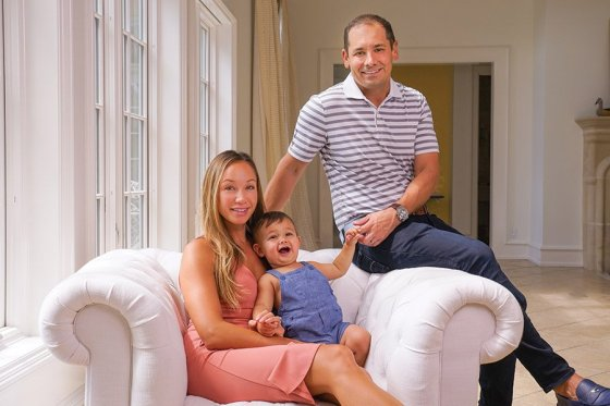 Rob McDonald with his wife, Alexa, and their son, Wells