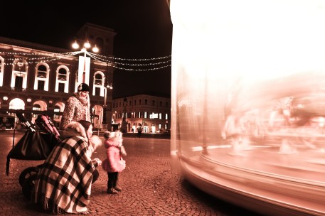 This little girl was absolutely captivated by this ride in Piazza Saffi