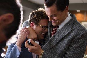 Leonardo DiCaprio hugs Jonah Hill in The Wolf of Wall Street