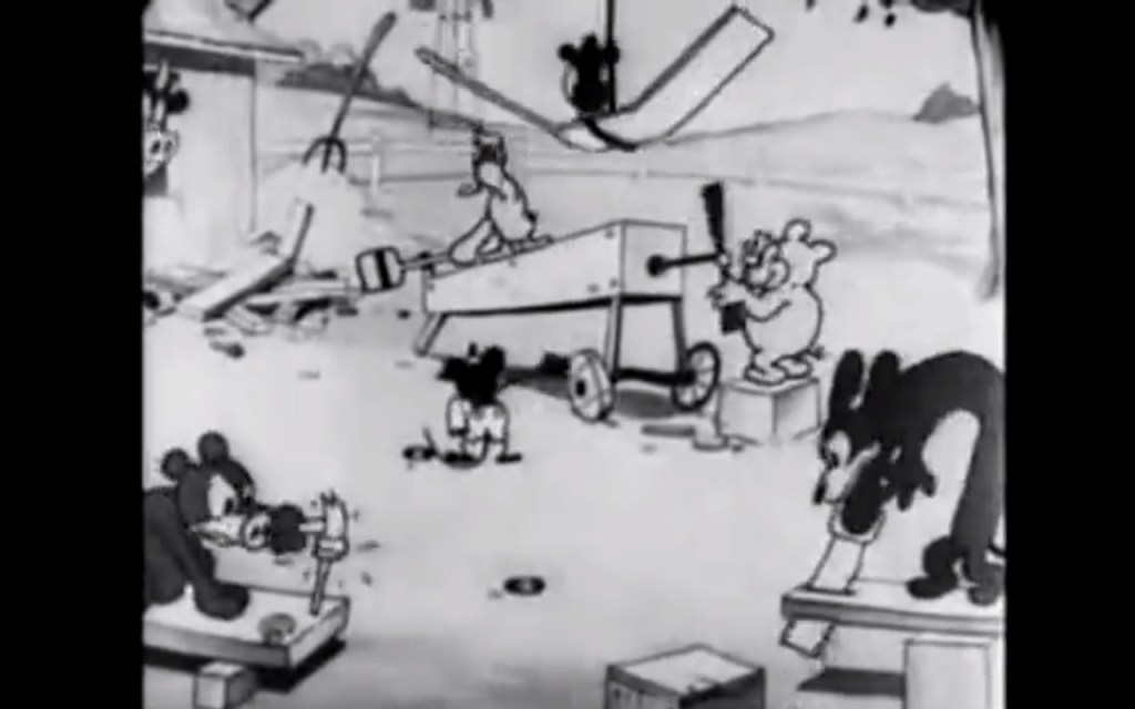 Mickey conducts the construction of his plane.