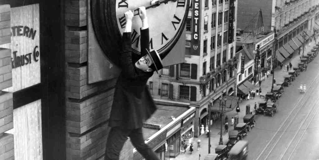 http://www.vod-consulting.net/wp-content/uploads/2013/08/HLE102635-Safety-Last-1923-dangling-from-clock-2.jpg
