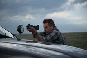 Kevin Bacon Has An Uzi And One Hell of A Moustache In first Stills From New Action/Thriller COP CAR