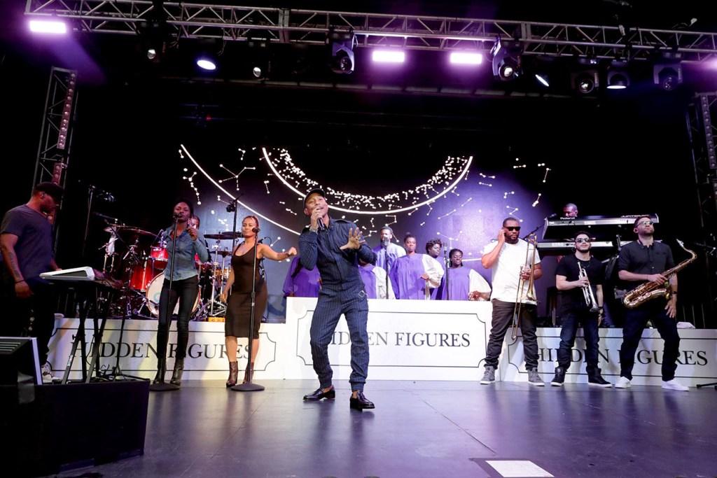Pharrell Williams performs at Twentieth Century Fox HIDDEN FIGURES LIVE at the 2016 Toronto International Film Festival on Saturday, Sept. 10, 2016, in Toronto. (Photo by Eric Charbonneau/Invision for Twentieth Century Fox/AP Images)