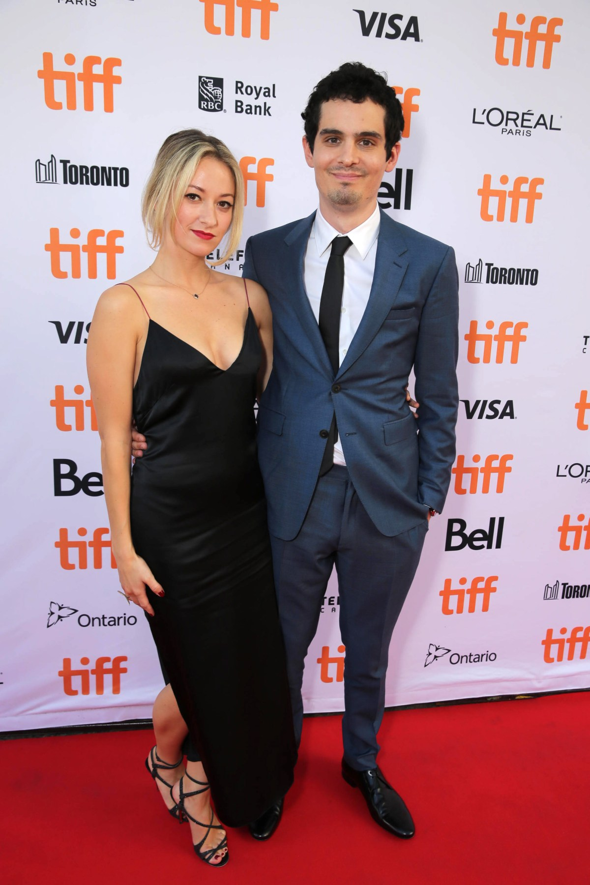 "Olivia Hamilton and Writer/Director Damien Chazelle seen at Summit Entertainment's ""La La Land"" premiere at the 2016 Toronto International Film Festival on Monday, Sept. 12, 2016, in Toronto. (Photo by Eric Charbonneau/Invision for LionsgateAP Images)"