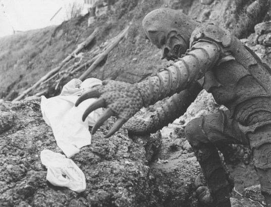 The Monster of Piedras Blancas grabs white bikini