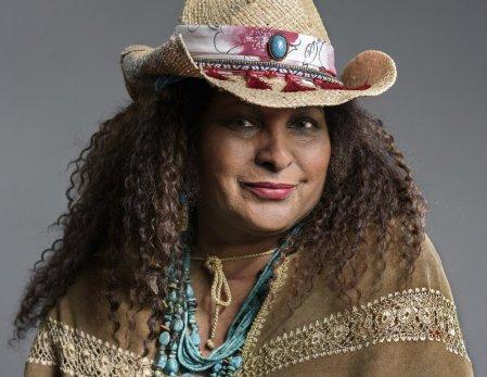 Pam Grier wearing a hat