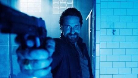 Copshop-movie-film-action-thriller-2021-Gerard-Butler-gun