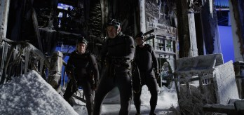 """L-r, Terry Notary, Andy Serkis and Michael Adamthwaite on the set of Twentieth Century Fox's """"War for the Planet of the Apes."""""""