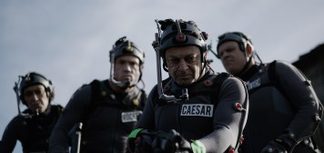 """L-r, Karin Konoval, Terry Notary, Andy Serkis and Michael Adamthwaite on the set of Twentieth Century Fox's """"War for the Planet of the Apes."""""""