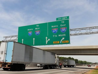 Photo of big green sign on I-75 northbound at Walt Stephens Road bridge (Trucks.com photo/Brian Hadden)