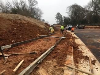 Contractors build new sidewalk along highway 81 in McDonough. (Georgia DOT photo)