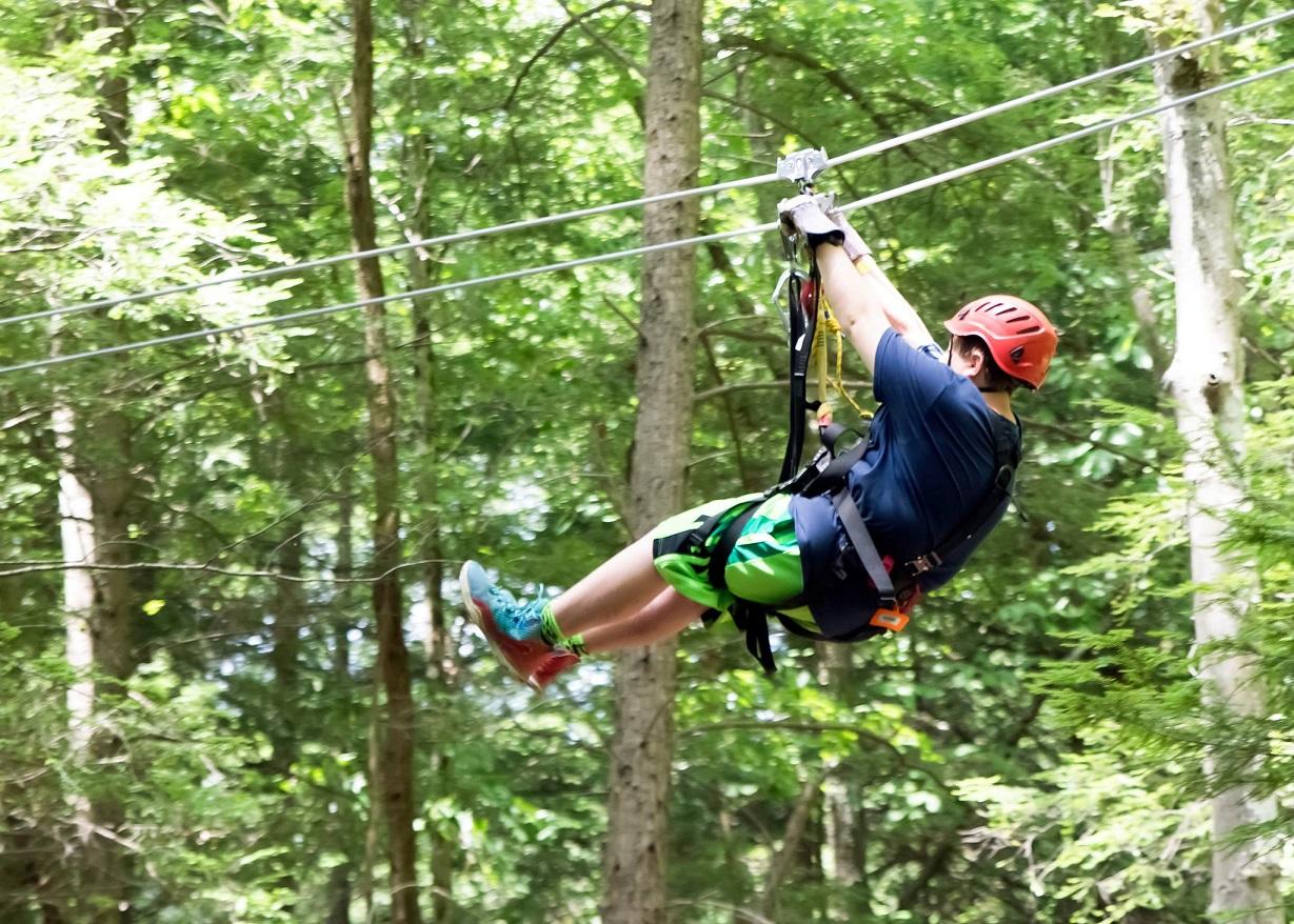 Photo of participant on canopy tour (Summit Bechtel Reserve photo)