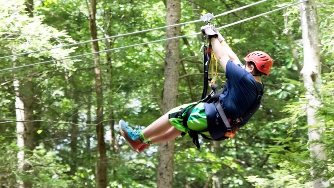 Photo of participant on canopy tour (Summit BSA photo)
