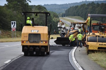 Photo of work crew resurfacing a roadway (Georgia DOT photo)