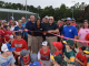 Commissioner Gary Barham cuts the ribbon on the North Ola Park expansion surrounded by youth baseball players (special photo)