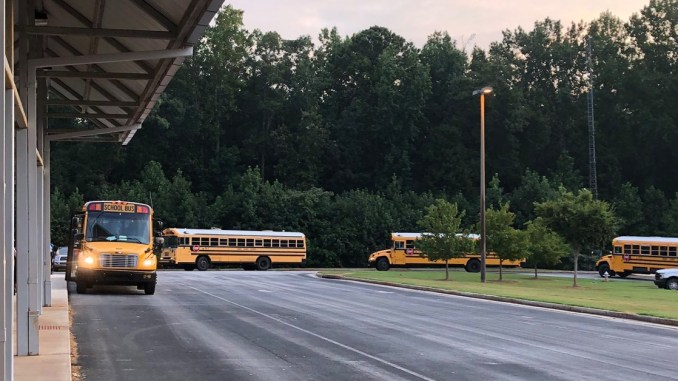 Photo of Henry County School buses arriving at school (Henry County Schools photo).