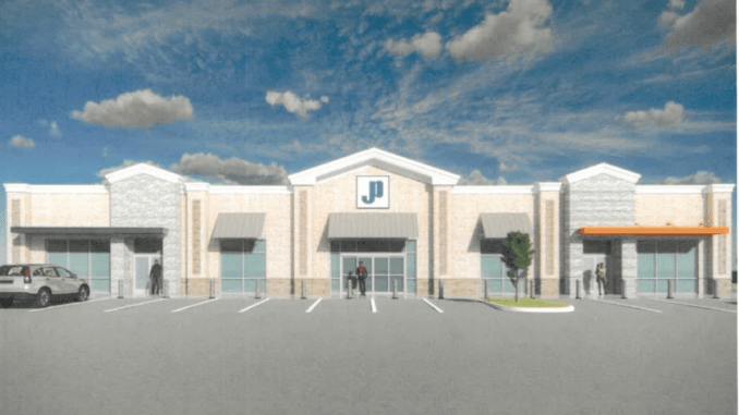 Photo shows the concept front elevation for a Jones Petroleum gas station. The building has a mixture of glass windows and brick exterior with the JP logo above the front door (Jones Petroleum photo).