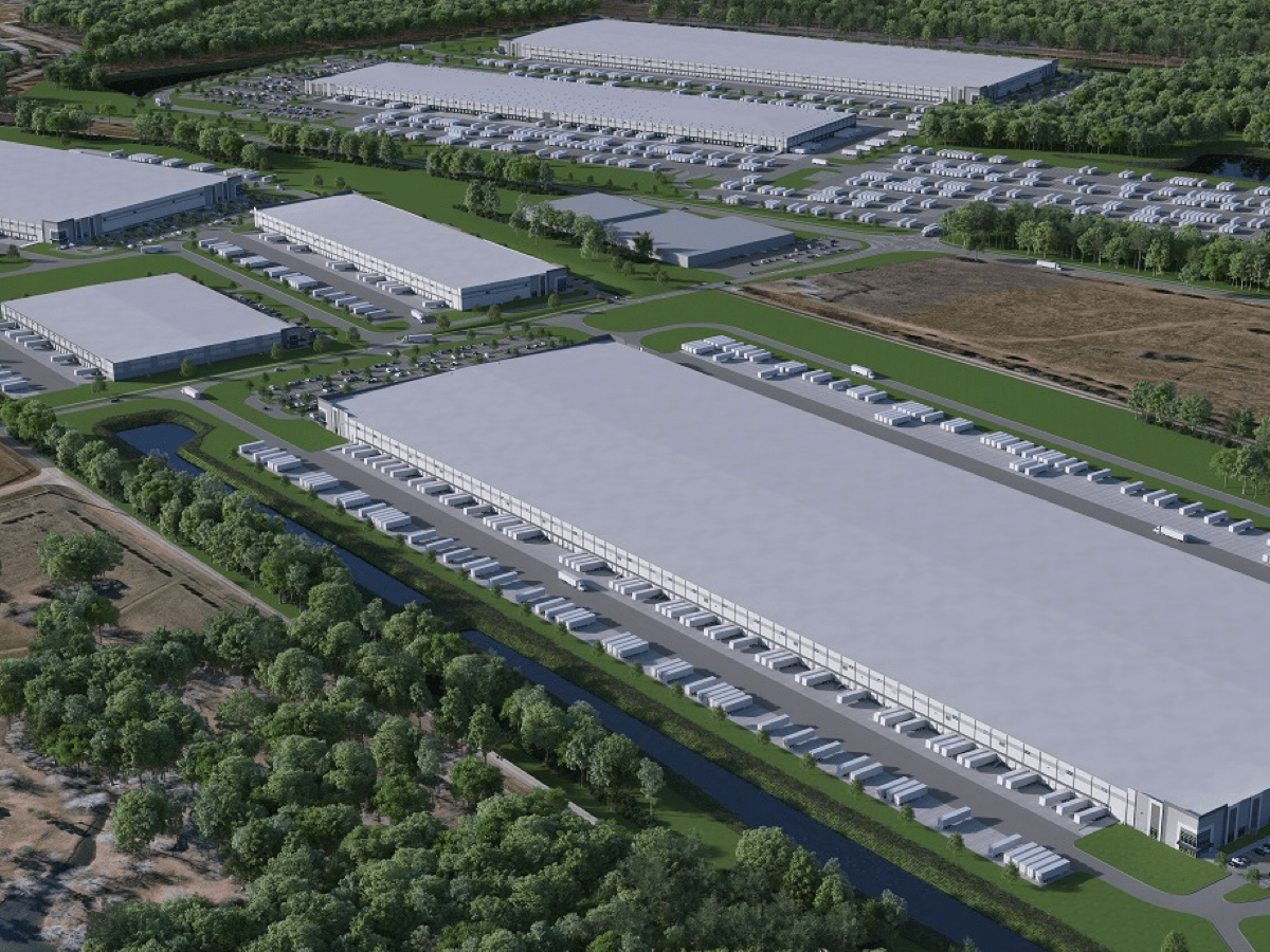 Photo shows several large industrial buildings with truck parking around them. Photo shows concept for Gardner Logistics Park in Locust Grove (Scannell Properties photo).