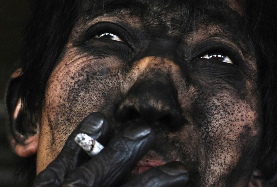 Le visage d'un mineur de charbon chinois.