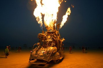 "The ""Rabid Transit"" Burning Man art car erupts with flames from it's onboard propane poofers during the 4th day of the annual Burning Man arts and music festival in the Black Rock Desert of Nevada"