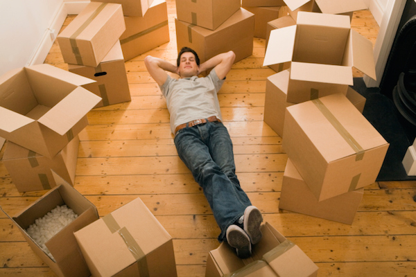 man relaxing with boxes