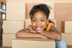 child leaning on box