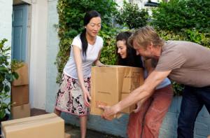 people lifting a box