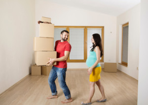 pregnant couple with boxes
