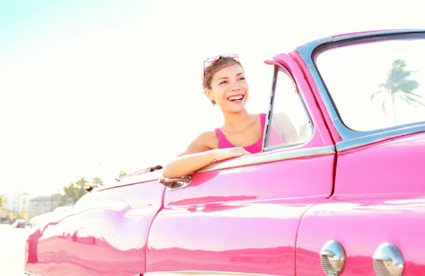 woman in pink car