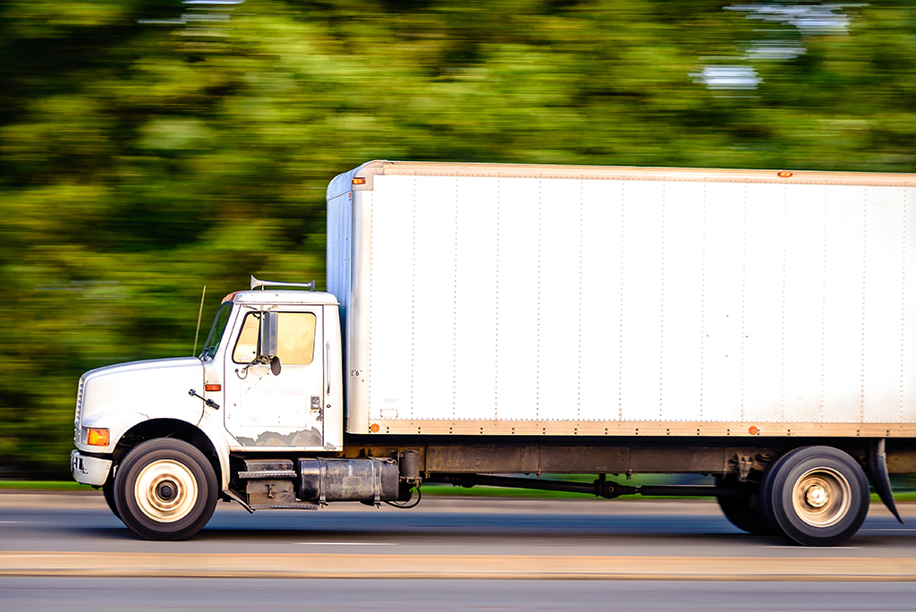 moving rental truck speeding on the highway