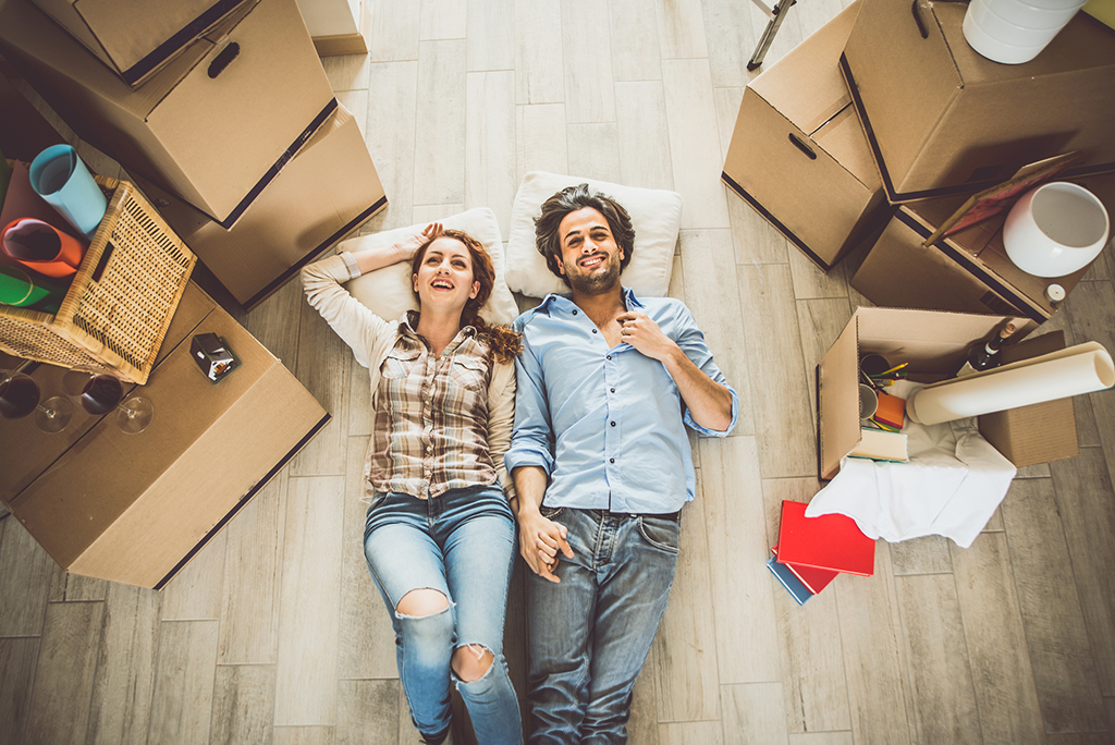 couple on floor with boxes