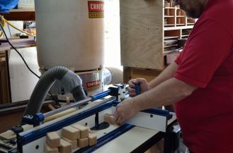 The router table also has a mitre guage mounted over the fence for easy work routing at a 90* angle.