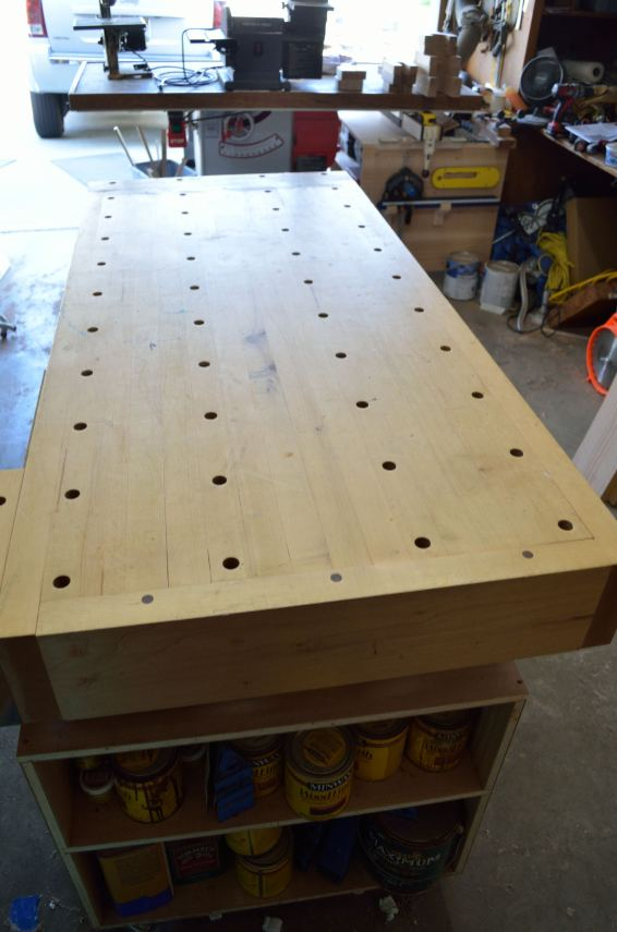 "The workbench is the centerpiece of every project in the shop. I built this one with holes across the hard maple top. With the end vise (on the other end), I can clamp large projects using ""bench dogs"" in the holes to hold the piece in place."