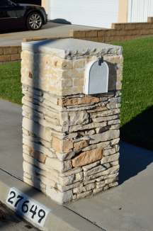 Why are there 2 kinds of rock plus concrete to cover this poor little mailbox?
