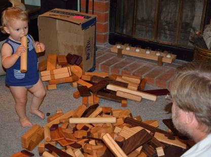 Payton meets the blocks. Too many for the family room!