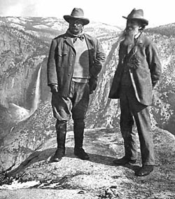 President Theodore Roosevelt, left, poses with John Muir for pictures on Overhanging Rock at the top of Glacier Point, near which the men camped in a hollow and awoke to five inches of snow in 1903.