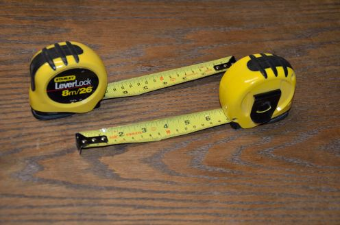 You need 2 identical tape measures: one lives on the table saw, and the other is at the work site.