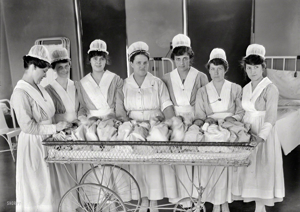 "Washington, D.C., circa 1919. ""Maternity ward. Nurses with babies."" Please have your claim check ready. Harris & Ewing Collection glass negative. Shorpy Historical Photos."