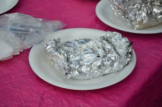 Get the pouch pocket off of the coals and put it on a thick paper plate ... don't touch it, it's very hot.
