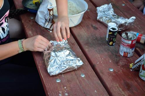 Fold, but don't tear the aluminum foil. If you have a hole, all of the moisture will escape and that will be bad.