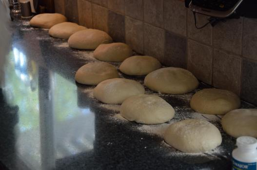 Pizza dough, ready for their final rise to room temperature. 12 pizzas means this is a relatively small production tonight.