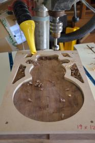 """Use a drill press and a forstner bit to """"hog out"""" the waste inside the shape of the bowl."""