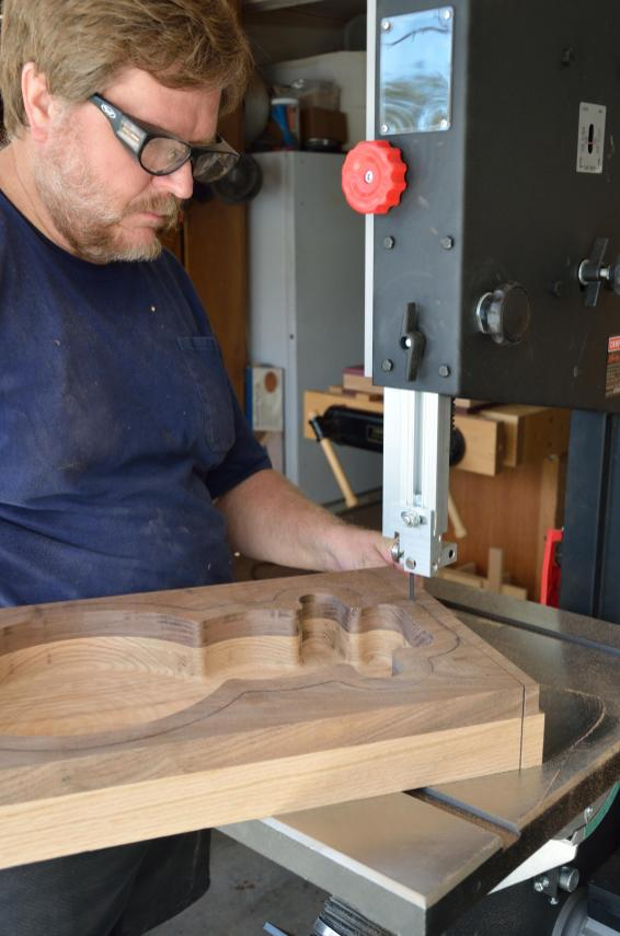 Use a bandsaw to slice away the wood that isn't the bowl.